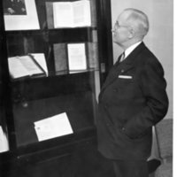 Photo taken by Herbert C Roy of former President Harry S. Truman oberserving a photo of Winston Churchill, Westminster College in Fulton, Missouri, 1955