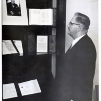 Photo taken by Herbert C Roy of former President Harry S. Truman oberserving a photo of Winston Churchill, Westminster College in Fulton, Missouri, 1957