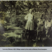Lawrence Dehoney with Collings cousins by the creek