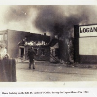 Drew Building on the left, Dr. Laffoon's Office, during the Logan-Moore Fire 1943