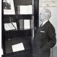 Photo taken by Herbert C Roy of former President Harry S. Truman oberserving a photo of Winston Churchill, Westminster College in Fulton, Missouri, 1954